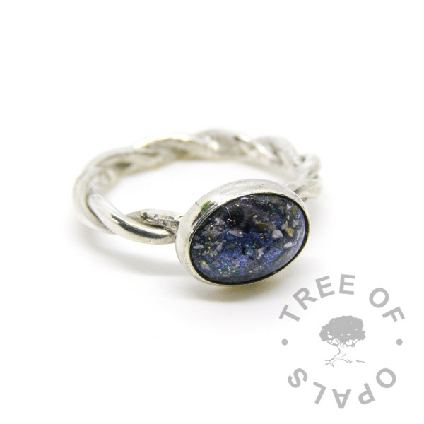 Aegean blue cremation ash ring on twisted band