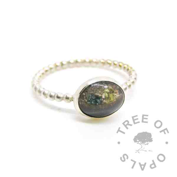 lock of hair and cremation ash ring, on a bubble wire band with three birthstones