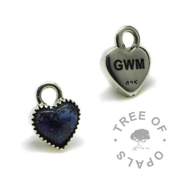 blue cremation ash heart charm with serrated setting, 10mm heart, shown with the back engraved