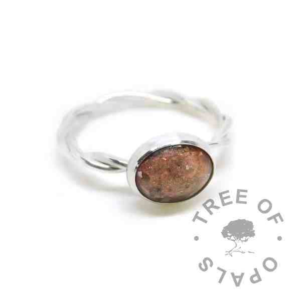 cremation ash memorial ring with tangerine orange resin sparkle mix. Solid sterling EcoSilver handmade setting with twisted wire band style. 10x8mm cabochon (stone) cremation ash ring