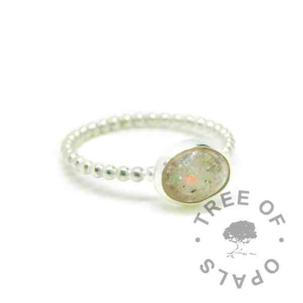 Classic clear resin cremation ash ring with October birthstone opal slices on a bubble wire band. Solid 935 aregentium silver handmade ring. Cremains ring. 10x8mm bezel cup rubbed over the cabochon for security.