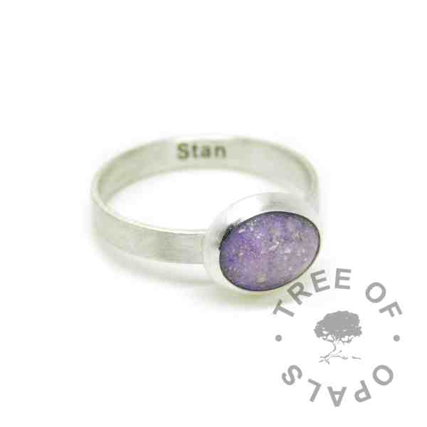 orchid purple cremation ash ring on a brushed wire band . Solid 925 sterling EcoSilver handmade ring. Cremains ring with engraved text on the inside of the band, in Arial font (some text removed for privacy). 10x8mm bezel cup rubbed over the cabochon for security.