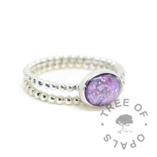 purple cremation ash ring and stacking ring. Cremation ashes with orchid purple resin sparkle mix, set in a 10x8mm cabochon on a bubble wire band, with a bubble wire stacking ring. Watermarked copyright image by Tree of Opals