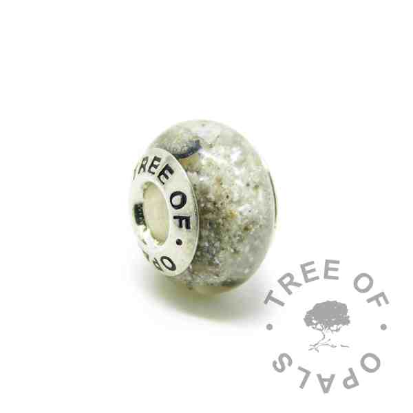 Cremation ash charm with unicorn white resin sparkle mix, naturally dark ashes, no birthstone. Solid sterling silver Tree of Opals signature core (925 stamped on the back). Watermarked copyright Tree of Opals memorial jewellery image