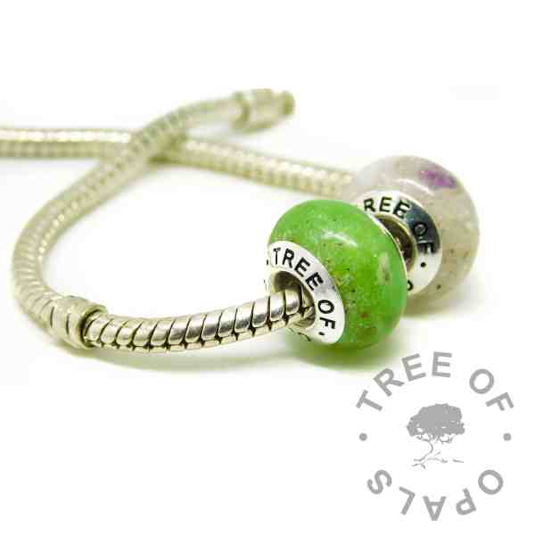 ash charm duo on Pandora bracelet style chain