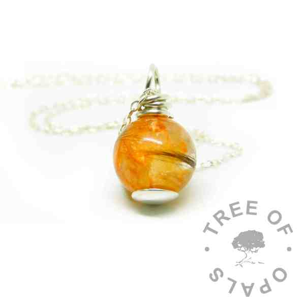 tangerine orange lock of hair pearl with smooth base and wire wrapped necklace setting