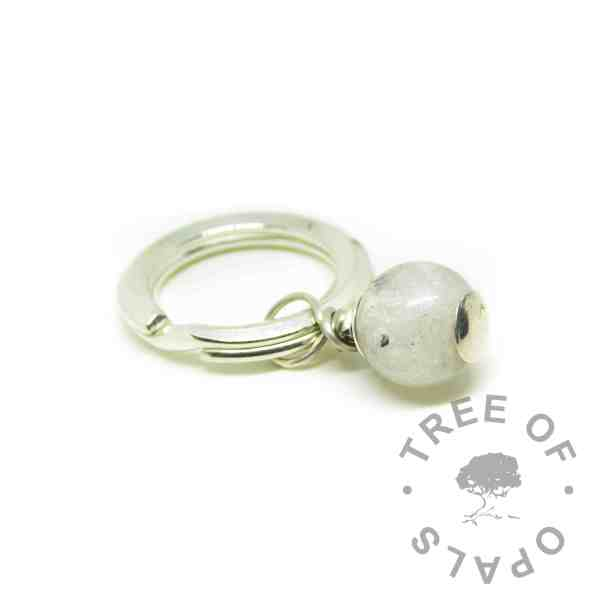 Cremation ash pearl with unicorn white resin sparkle mix. Set on a heavy solid sterling silver split ring keyring setting