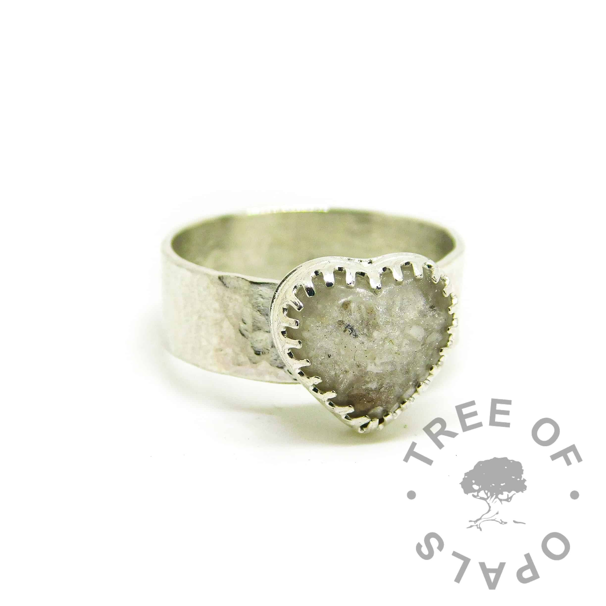 white heart ashes jewellery ring on textured 6mm band, cremation ashes and unicorn white resin sparkle mix in a 10mm scalloped heart setting