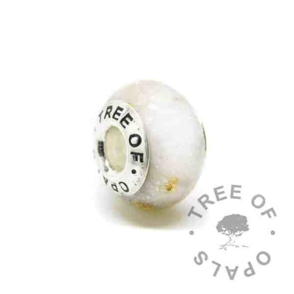 breastmilk bead with subtle unicorn white resin sparkle mix and gold leaf. Tree of Opals core