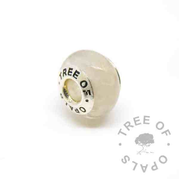 breastmilk bead with golden pearly breastmilk sparkle mix. Tree of Opals core