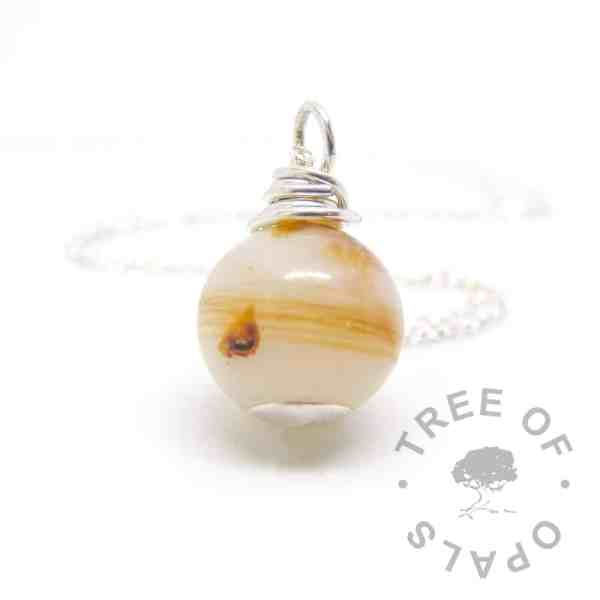 breastmilk pearl with lock of hair and cord