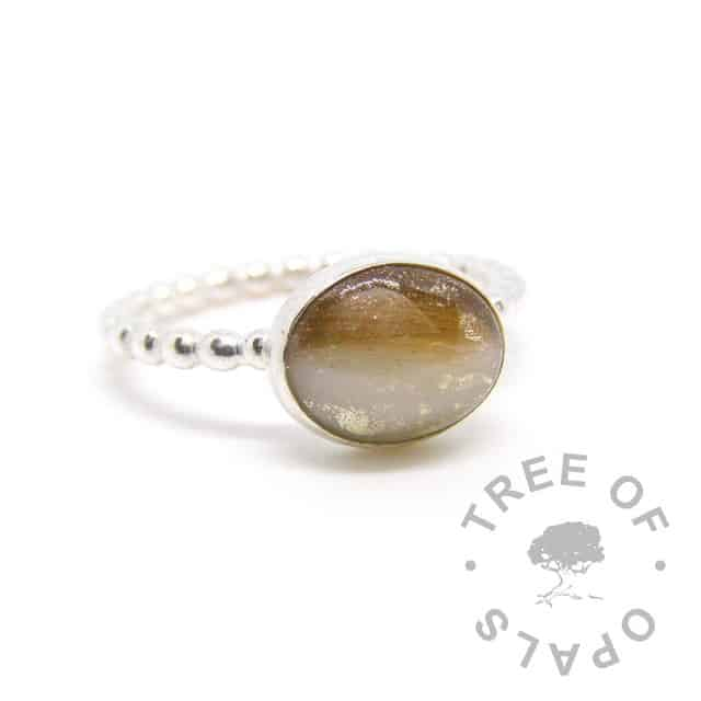 silver breastmilk ring, 10x8mm setting with hair and breastmilk, white gold leaf. 2mm bubble band, 935 anti-tarnish silver