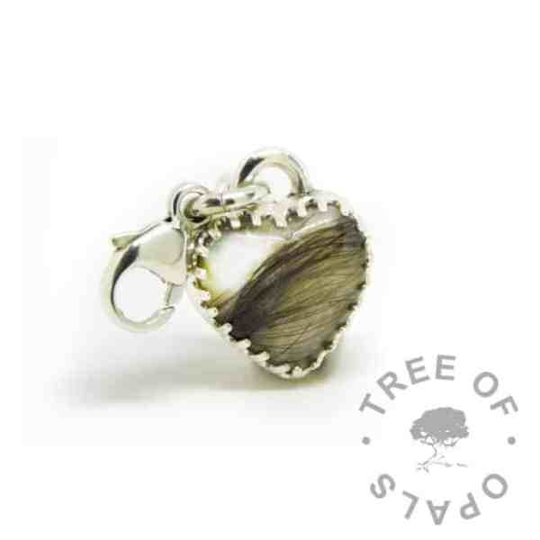 silver breastmilk heart charm with 10mm scalloped heart setting with hair and breastmilk. 935 anti-tarnish silver silver setting and lobster clasp for Thomas Sabo style bracelets