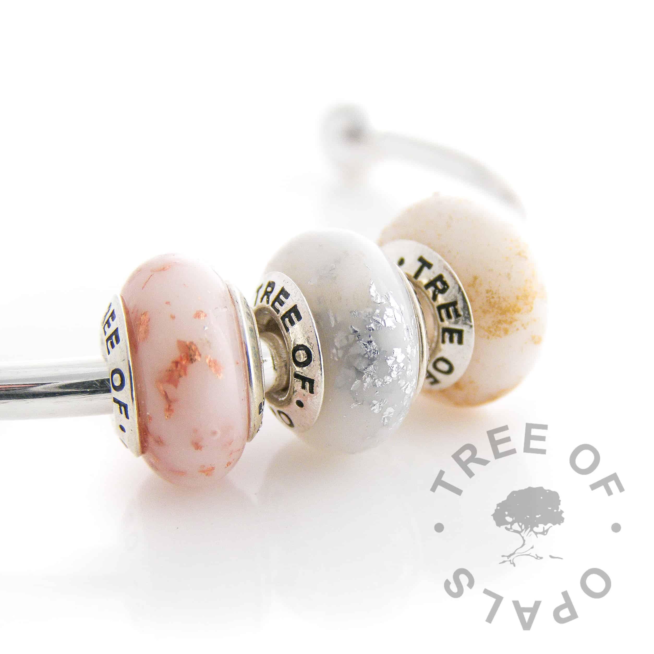 boobie awards bead trio. Copper = three months, silver = six months, gold = twelve months