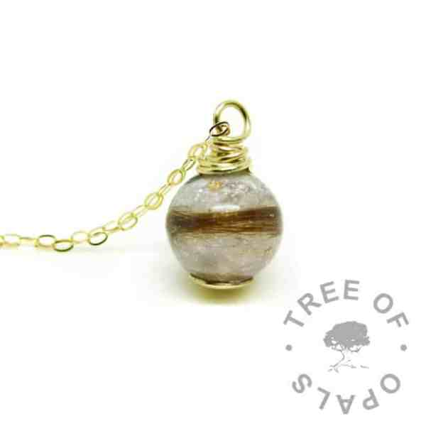 solid gold breastmilk orb necklace with unicorn white resin sparkle mix and baby's first curl
