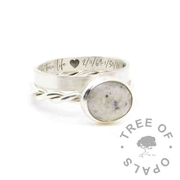 Ashes ring on twisted band with unicorn white resin sparkle mix. Shown with engraved stacking ring in Silver South Script font