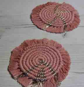 Pair of pink macrame coasters in bobbiny 'dusty pink and champagne' from HarrietsMacrame