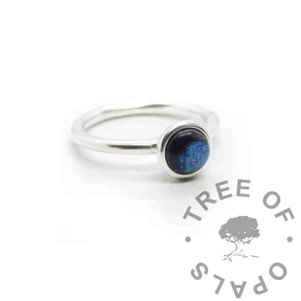 Ayla Lock of Hair Ring, blue hair Ayla Solitaire Ring, brunette hair, clear resin with Aegean blue resin sparkle mix made into a cabochon (stone) and set into the ring with glue. Cast Argentium 935 anti-tarnish silver (higher purity than sterling)