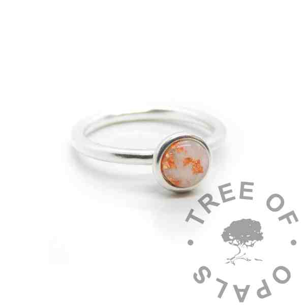 Mystery Piece Copper breastmilk Ayla Solitaire Ring, preserved dried breastmilk in resin with copper leaf made into a cabochon (stone) and set into the ring with glue. Copper represents the three month breastfeeding award. Cast Argentium 935 anti-tarnish silver (higher purity than sterling)