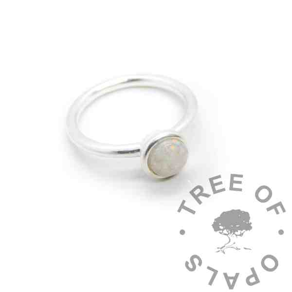 Opal breastmilk Ayla Solitaire Ring, preserved dried breastmilk in resin with synthetic opal pieces made into a cabochon (stone) and set into the ring with glue. Opal represents the five year breastfeeding award and also the October birthstone. Cast Argentium 935 anti-tarnish silver (higher purity than sterling), shown from above
