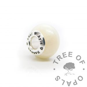 Breastmilk bead with engraved bead core exclusively from Keepsaker Supplies. Small amounts of text can be engraved directly onto the bead core now