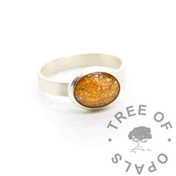 cremation ash ring 3mm brushed band, 10x8mm bezel cup, tangerine orange resin sparkle mix with genuine rose gold leaf. Memorial jewellery with ashes