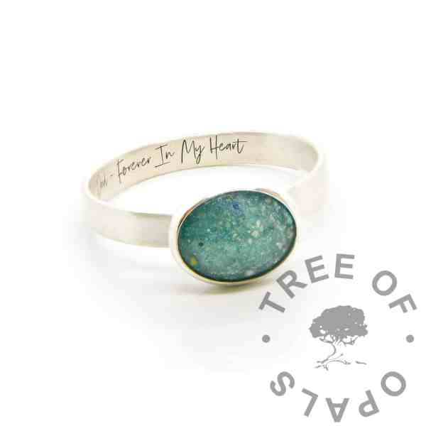 cremation ring 3mm brushed band, 10x8mm bezel cup, mermaid teal resin sparkle mix. Engraved inside in Silver South Script font. Dad - Forever In My Heart. Dad memorial jewellery with ashes
