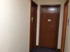 Just outside his door. 2 more dorm rooms & a bathroom.