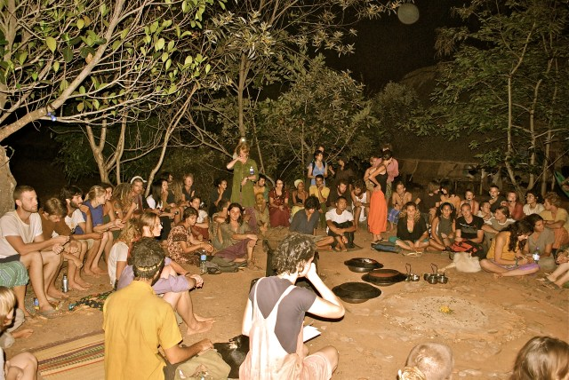 Community Meal outdoors under the trees that sprouted and supported from the earthworks