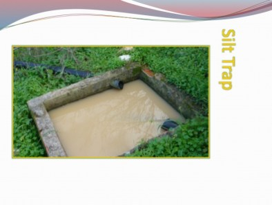 silt trap full showing cloudy water from clay particles which are harder to trap because of their suspension quality due to size