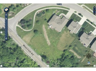 Swale seen from space in suburban backyard- on contour ditch and mound