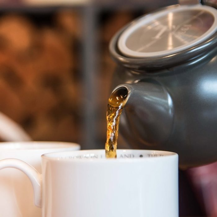 A freshly brewed British Tea poured from a Tregothnan Grey Tea Pot