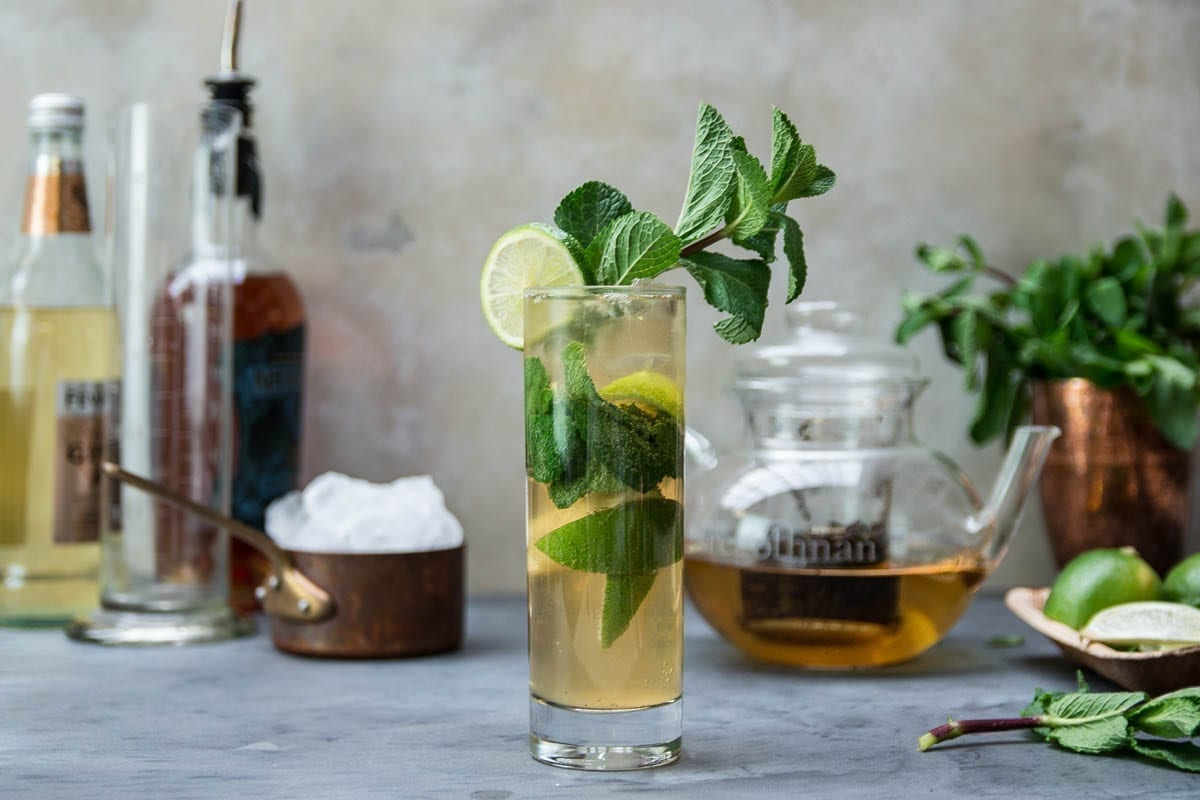 A Glass of Tregothnan Pit Pony Iced Tea Cocktail garnished with Mint and a slice of Lime