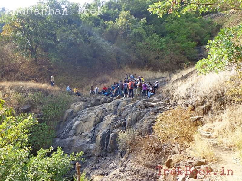andharban trek crossing the waterfall