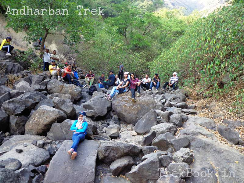andharban sitting in waterfall