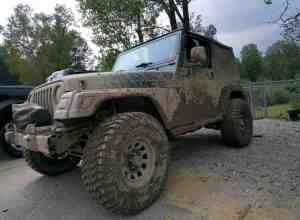 Mud-covered Jeep Wrangler