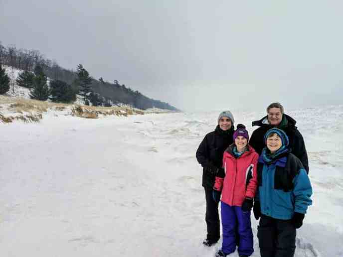 Family on Michigan beach in winter