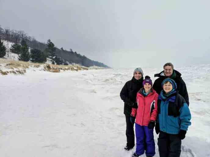 Family on Michigan beach in winter