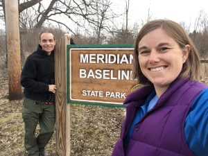 man and woman at state park sign