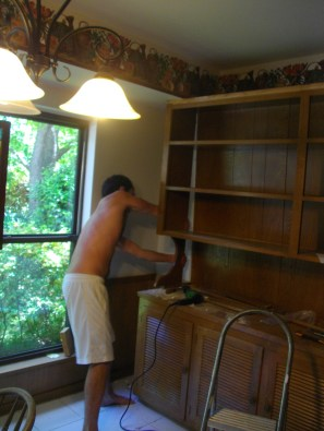 April 2014 and the cabinet/built in hutch comes tumbling down by Micah's diligence.