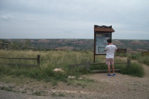 Micah looking at sign at Palo Duro Canyon State Park near Amarillo