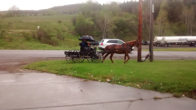 Amish getting gas at Shorts gas station in Wellsville, NY.