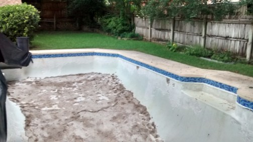 The tile done about the pool now to get the plaster back in place. :)