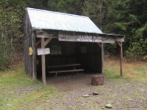 Shelter next to a large camp area.