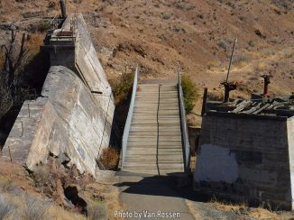 The old dam and gate house would hold water to be release as needed for power generation. Good place for a solar project.