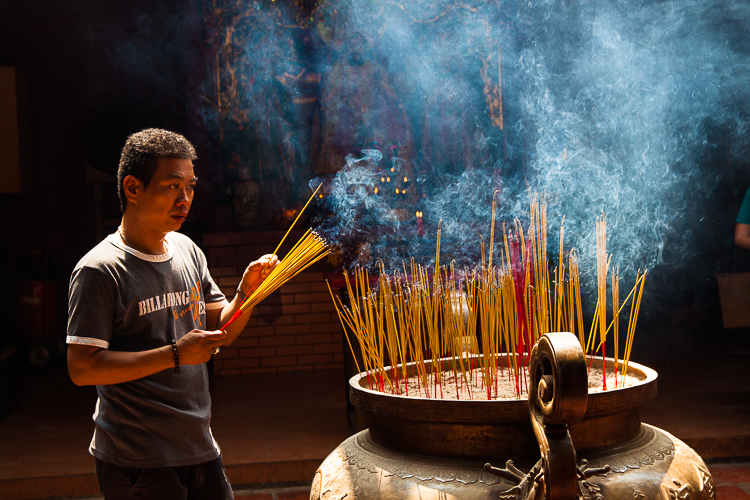 Incense from dozens of incense sticks fills the air