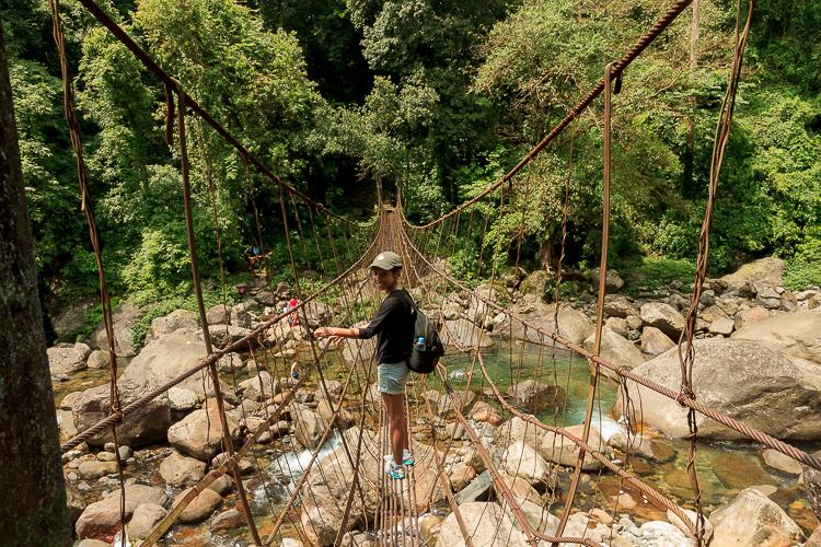 Medarisha on one of the many rope bridges on the route