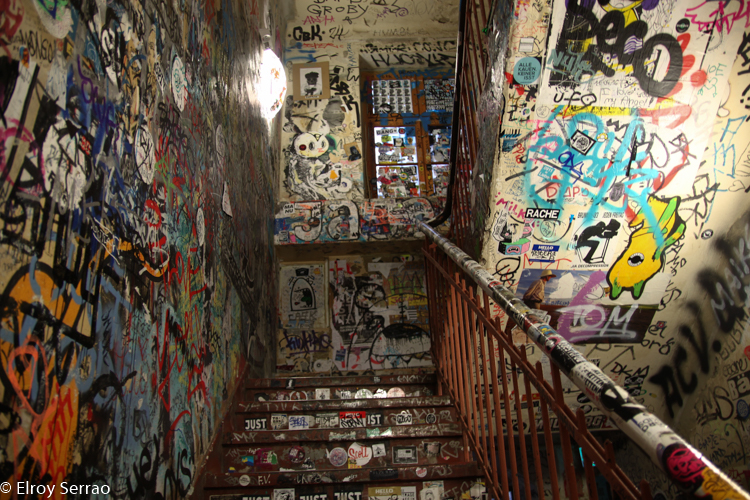 The inside of this building is completely covered in graffiti