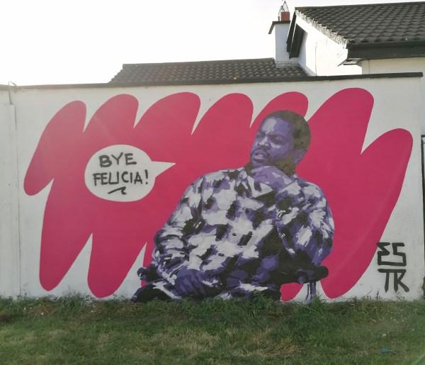 Street mural on a housing estate wall