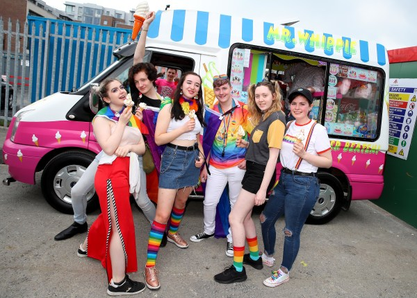 LGBT+ youths standing in front of an ice cream van wearing rainbow colours, image provided by Dublin Bus and BeLonG To latest campaign